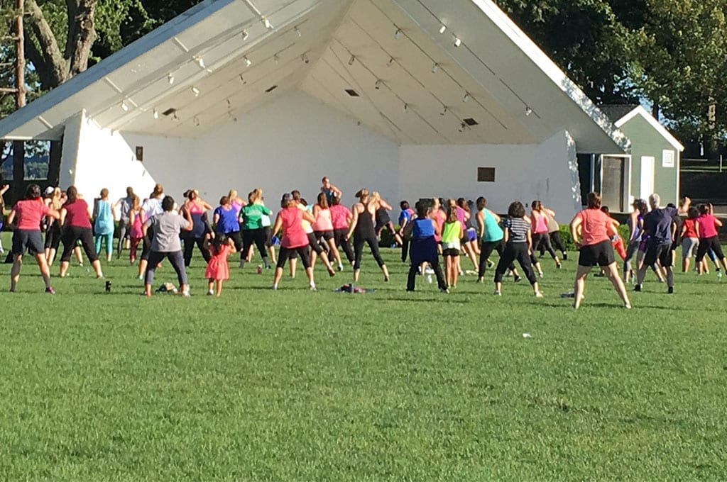 outdoor fitness class in spacious field at best athletic club near me